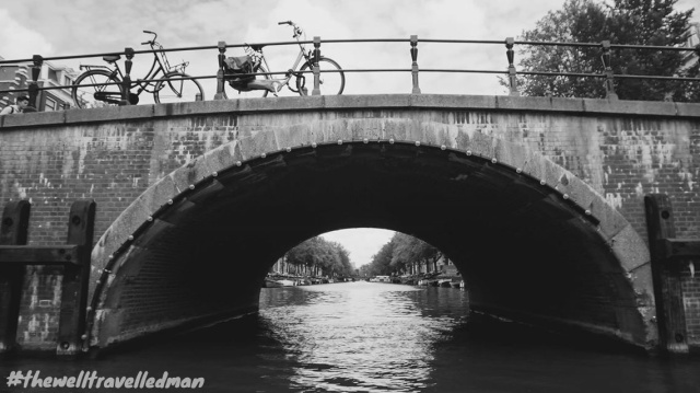 thewelltravelledman travel blog Amsterdam black and white bridge over canal