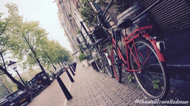 thewelltravelledman travel blog Amsterdam red bike on street