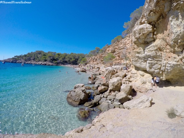 Cala Salada - the rock wall you need to climb over to get to the beach!