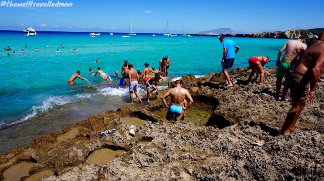 Cala Rossa, Favignana - how to get in to the water! It's a bit tricky and rock shoes would be very helpful :)